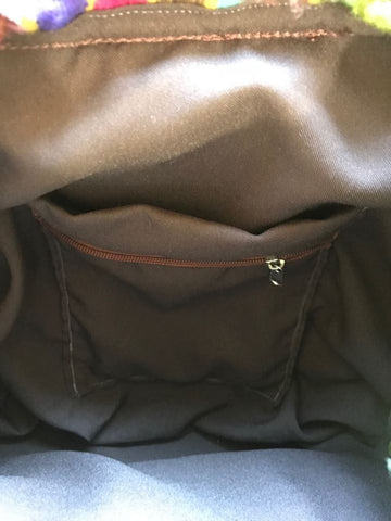 Zip/open pocket inside the wool backpack