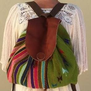 Green Oaxacan wool and leather backpack hand woven by master weaver in Mexico