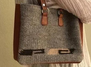 Small wool shoulder bag with leather straps