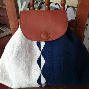 Natural and dark blue Oaxacan wool and leather backpack hand woven by master weaver in Mexico