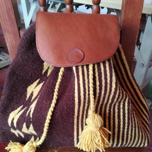 Burgundy and yellow Oaxacan wool and leather backpack hand woven by master weaver in Mexico