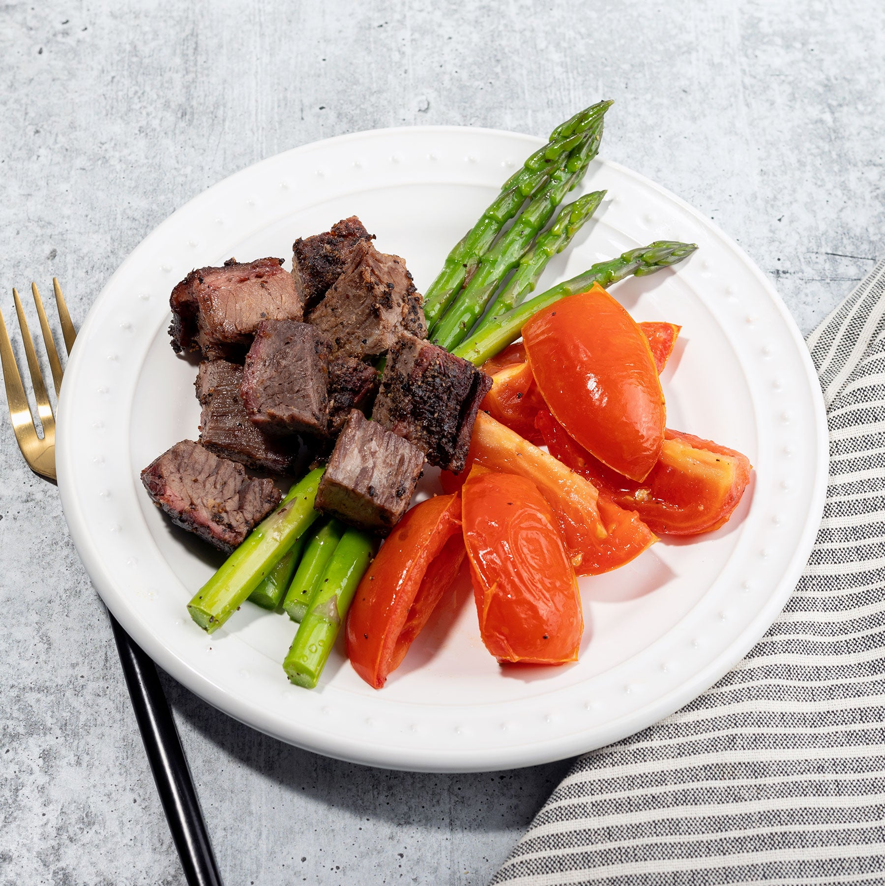 Peppercorn Crusted Brisket with Roasted Tomatoes and Asparagus