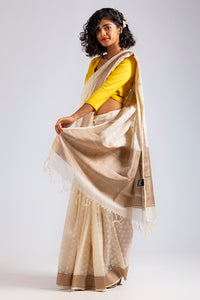 Pottu- Off White Cut Work Saree.