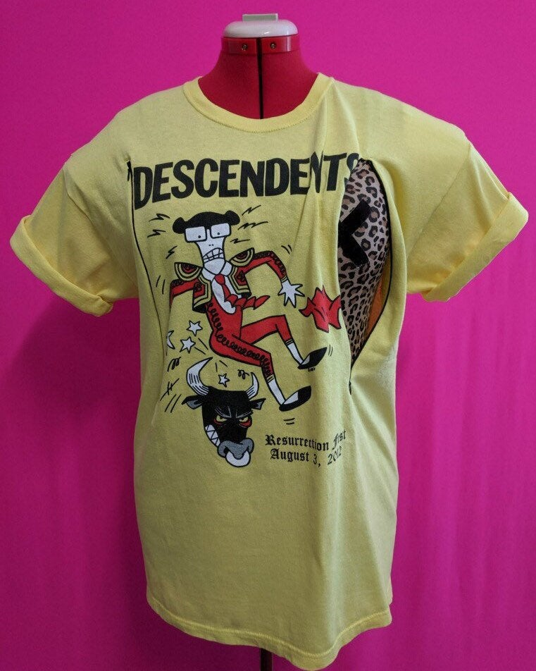 Yellow Descendents shirt with Matador Milo Design. Shirt has been customized for breastfeeding with two invisible zippers.