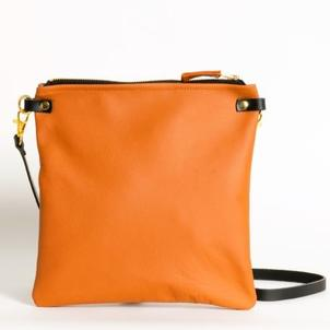 Harris Tweed and leather clutches in a selection of colours.