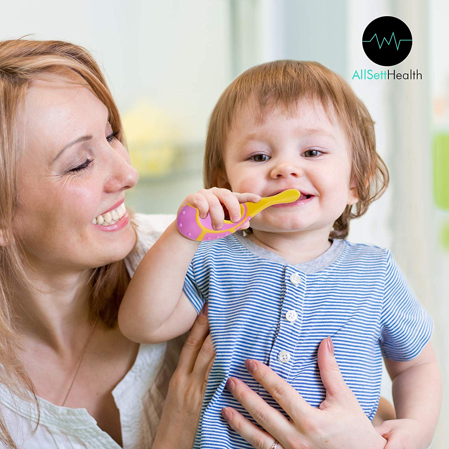 mom holding 2 year old brushing teeth