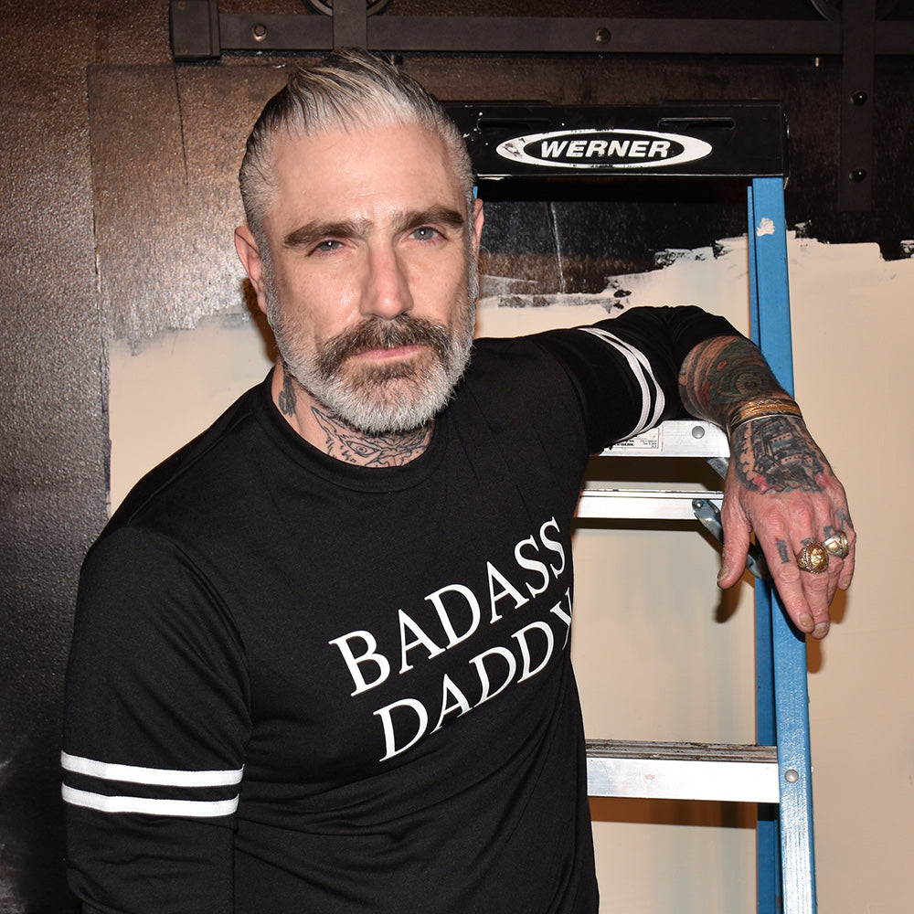 Badass Daddy on strapped long sleeve French Terry Sweatshirt