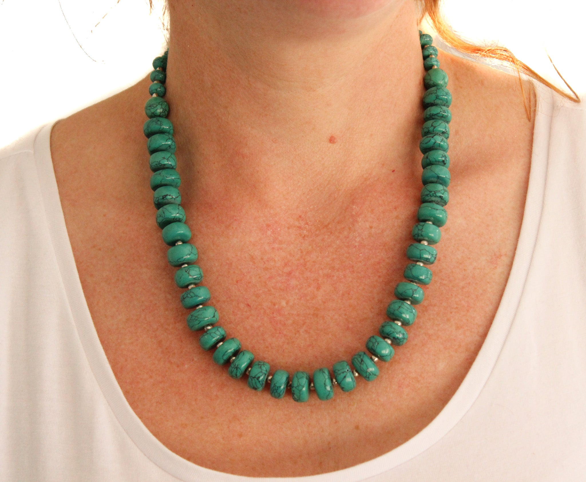 Turquoise strand necklaces