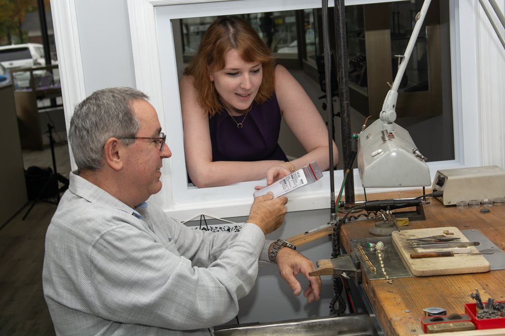 Master Jeweler Eddie goes over a client repair with Starflower's co-owner Cait.
