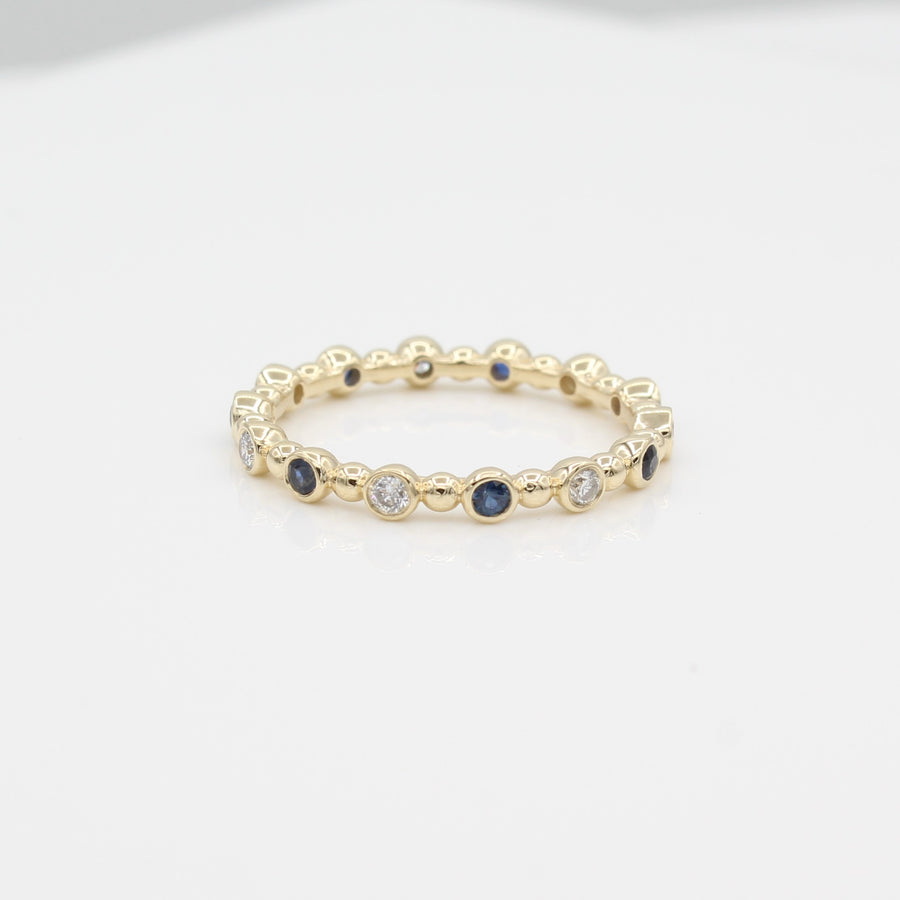 14k Yellow Gold Diamond & Sapphire 14 Station Beaded Eternity Band, front view.