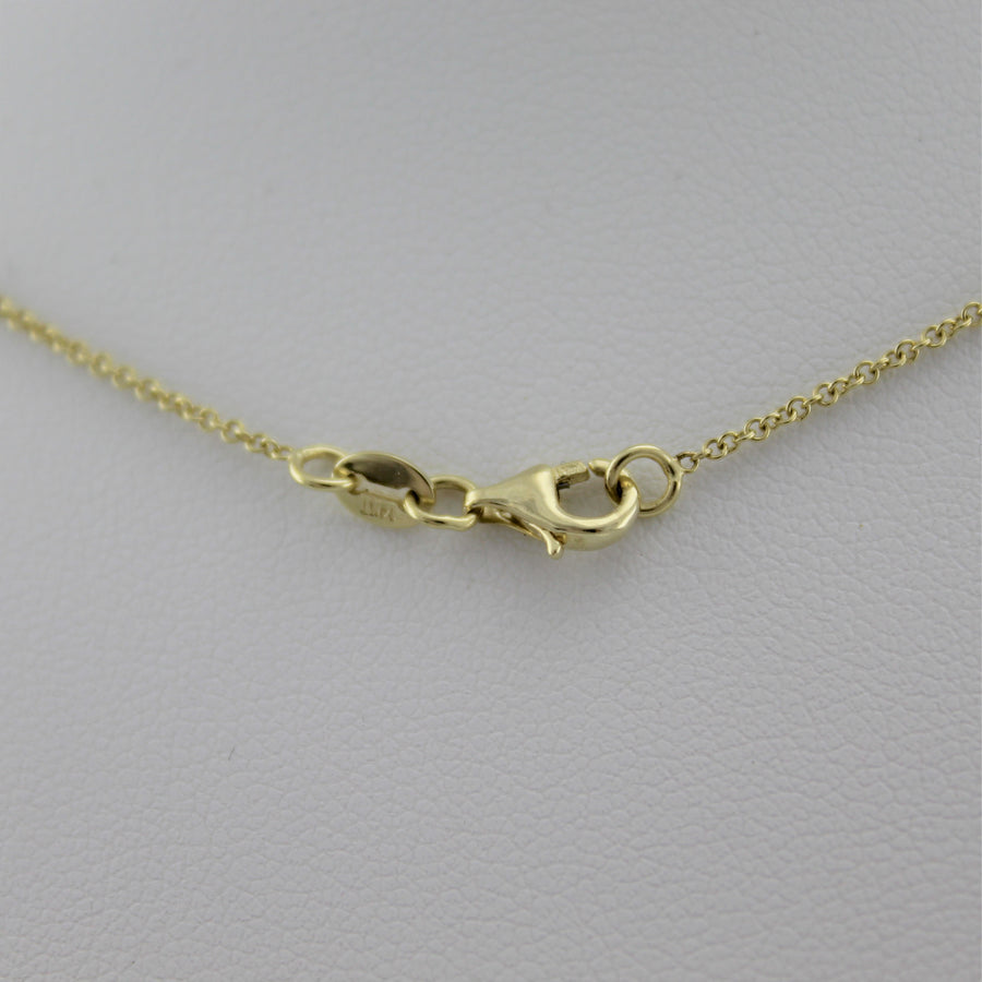 14k Yellow Gold Shining Star Pendant, a peak at the necklace's lobster clasp closure.