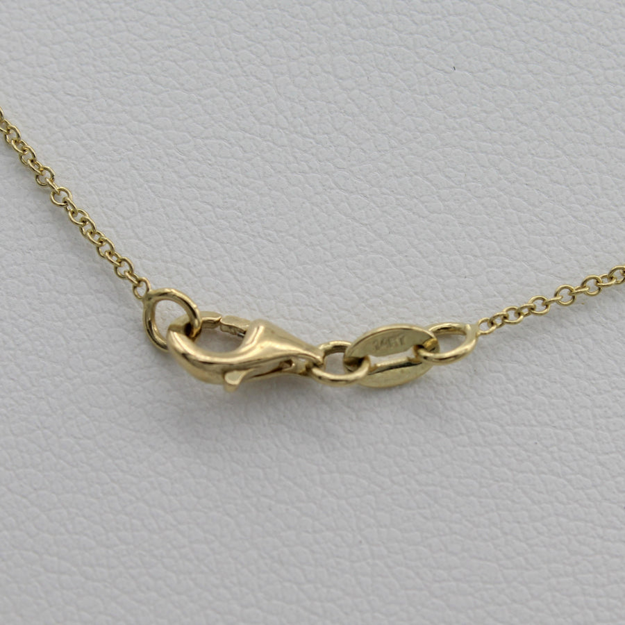 14k Yellow Gold Lightning Bolt Five Station Necklace, close-up of the necklace's lobster clasp closure.