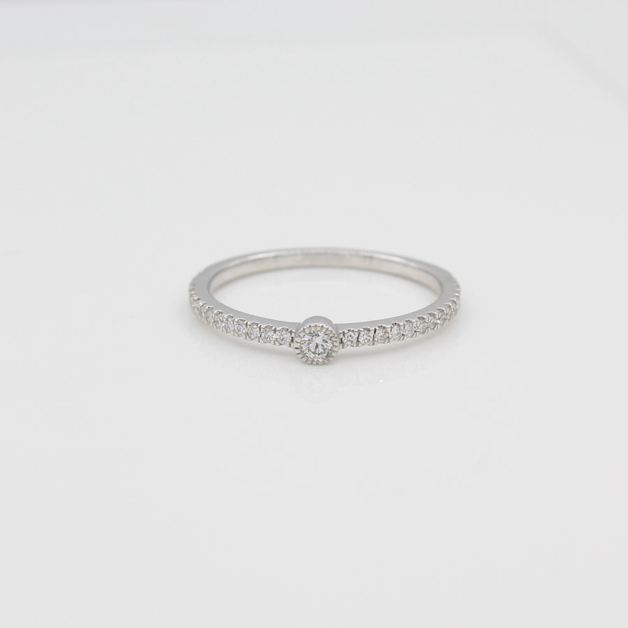 14k White Gold Single Bezel-Set Diamond Station Ring with Micro-Pave Band, front view.