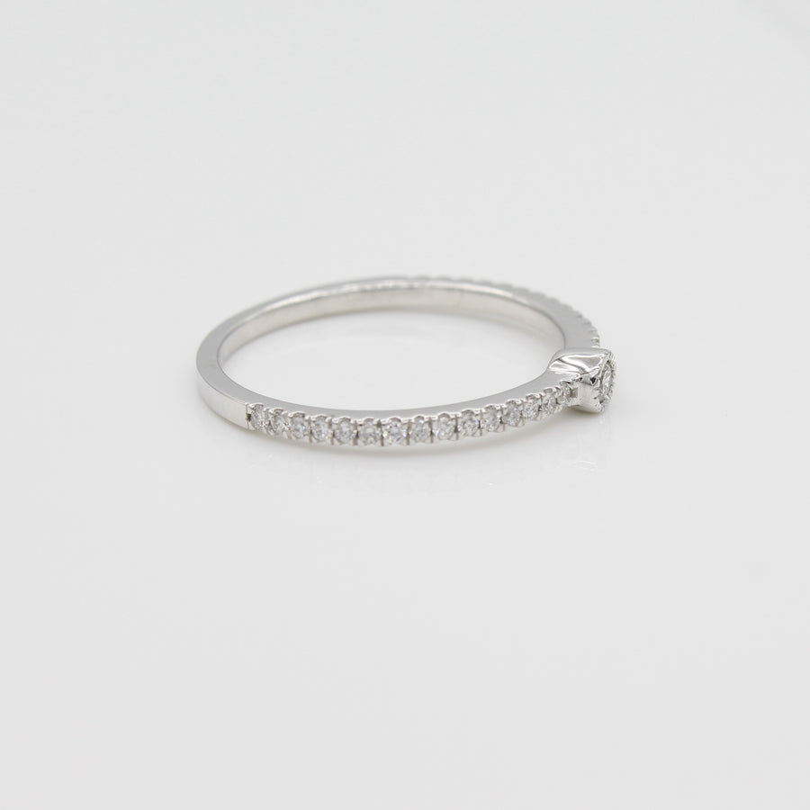 14k White Gold Single Bezel-Set Diamond Station Ring with Micro-Pave Band, side view from left.