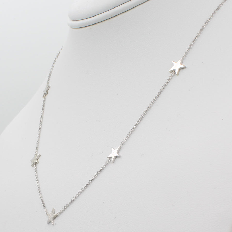 14k White Gold Five Station Star Necklace, right angle view of necklace displayed on mannequin neckline.