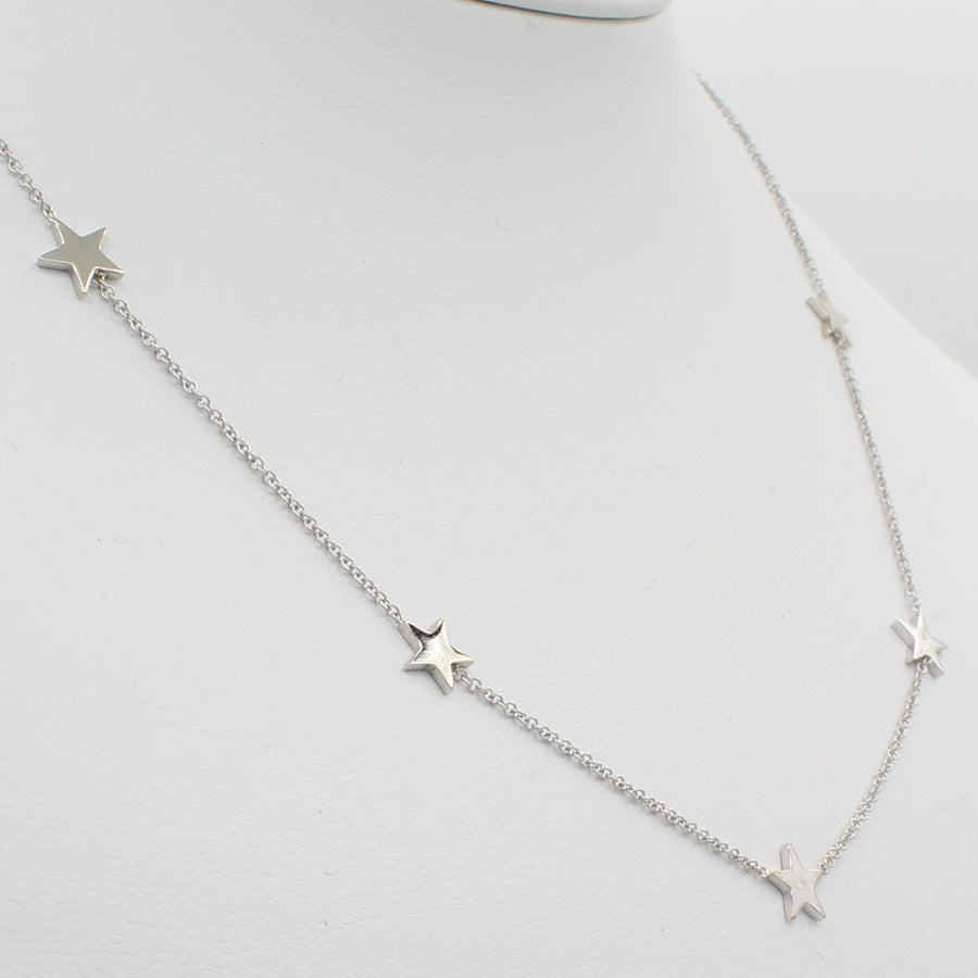 14k White Gold Five Station Star Necklace, close-up left angle view of necklace displayed on mannequin neckline.