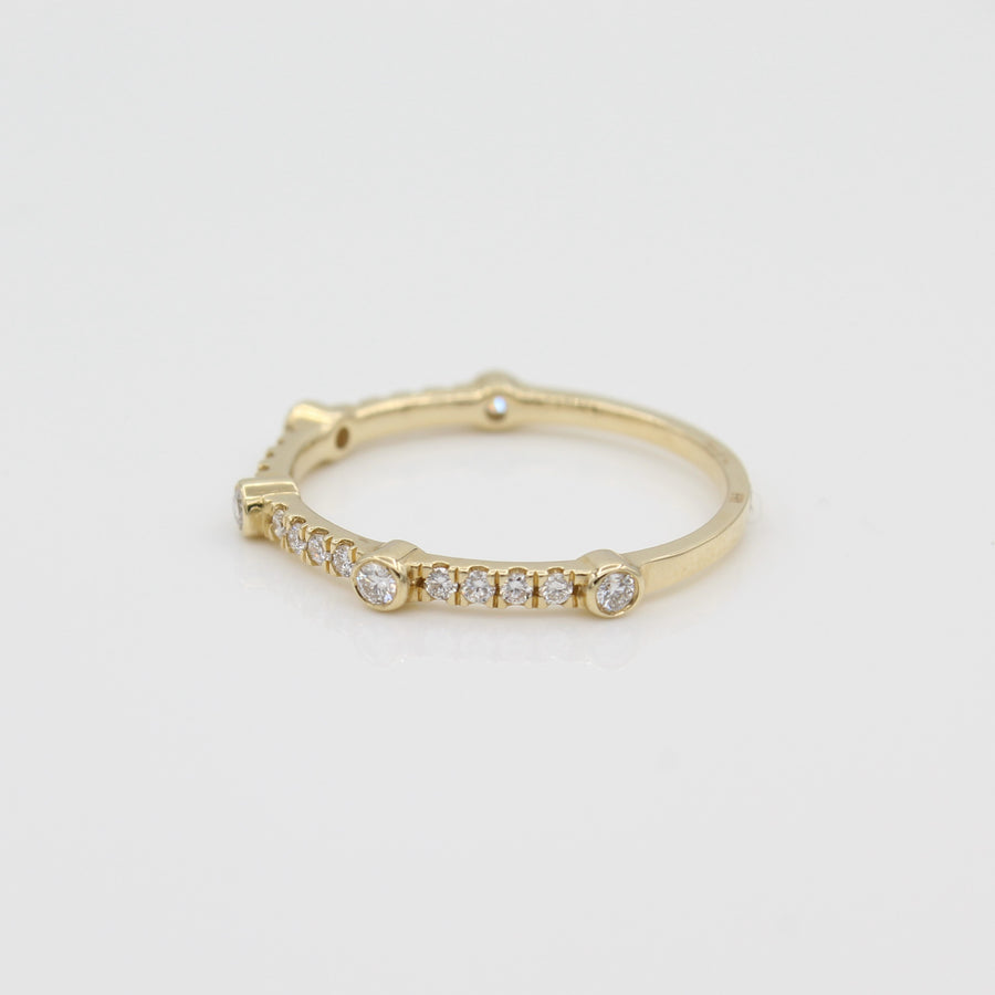 14k Yellow Gold Bezel-Set Diamond 5 Station Ring with Micro-Pave Band, side view from right.