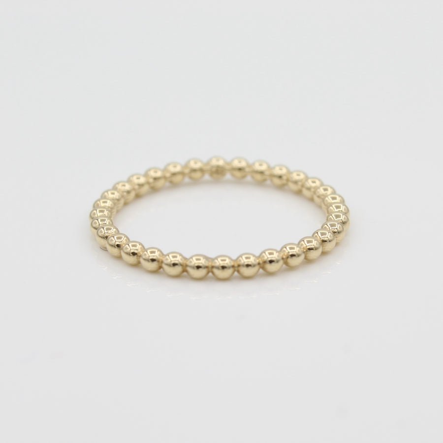 14k Yellow Gold Beaded Eternity Band, front view.