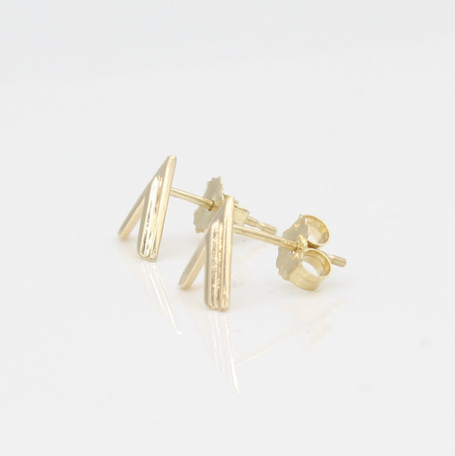 14k Yellow Gold Double Chevron Earrings, side view from right with a peak at the earring's posts and backs.