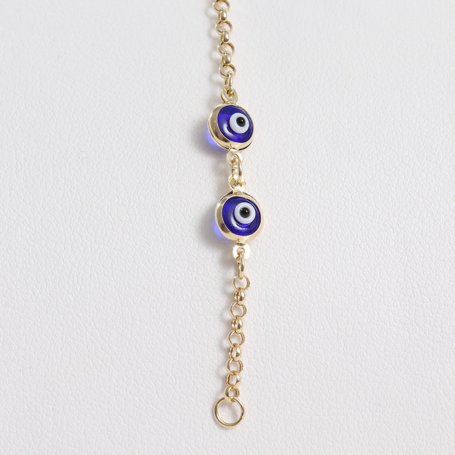 14k Yellow Gold Dark Blue Evil Eye Bead Chain Link Bracelet, a close-up view of the dark blue evil eye bead embellishment and closure loop.