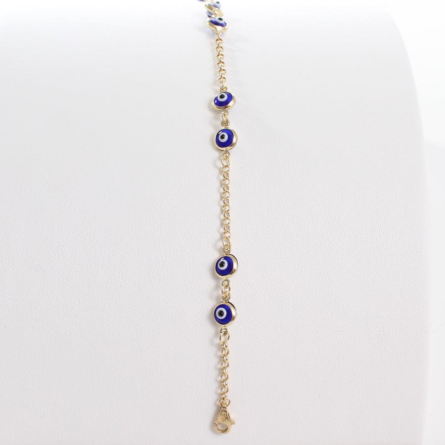 14k Yellow Gold Dark Blue Evil Eye Bead Chain Link Bracelet, a view of the unclasped bracelet laid out on a display and a peak at the lobster clasp closure.