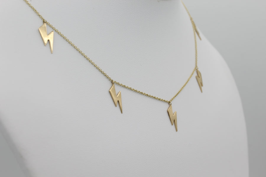 14k Yellow Gold Lightning Bolt Five Station Necklace, close-up left angle view of necklace displayed on a mannequin.