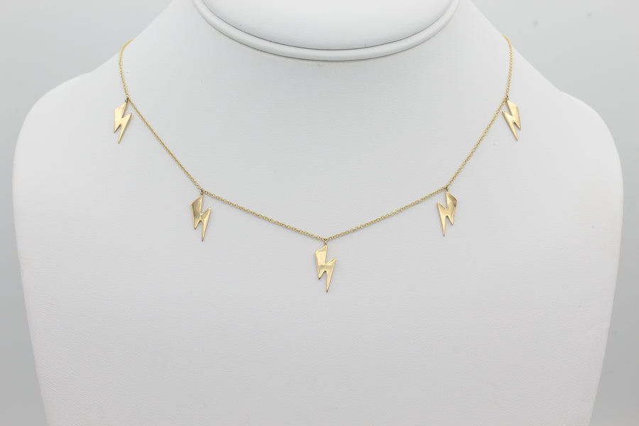 14k Yellow Gold Lightning Bolt Five Station Necklace, front view of necklace displayed on a mannequin.