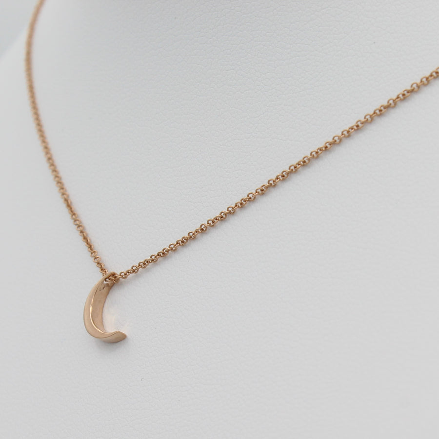 14k Yellow Gold Crescent Moon Pendant, right angle view of necklace displayed on a mannequin.