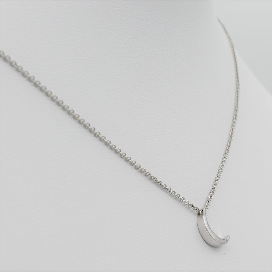 14k White Gold Crescent Moon Pendant, left angle view of necklace displayed on a mannequin.