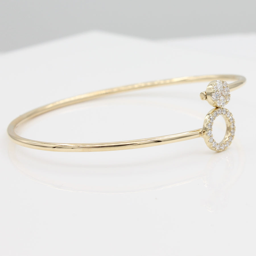 14k Yellow Gold Around & Around Locking Diamond Bangle Bracelet, side view from the left, displayed as a bangle with smaller diamond-encrusted circle stacked on top of larger diamond-set circle.