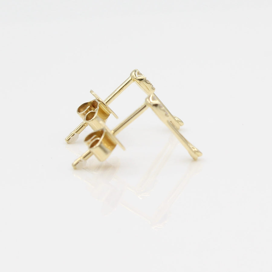 14k Yellow Gold Diamond Safety Pin Stud Earrings, side view from left with a peak of the earring posts and backs.