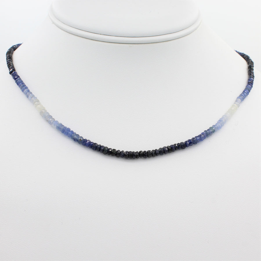 Beauty in Blue 40CT Adjustable Ombre Sapphire Choker Necklace, front view of necklace displayed on a mannequin neckline.