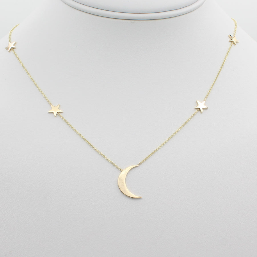 14k Yellow Gold Shoot for the Moon Station Necklace, front view of necklace highlighting the five station star and moon design.