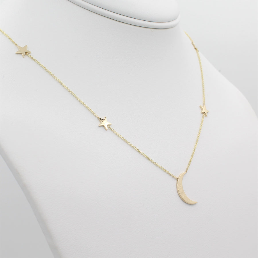 14k Yellow Gold Shoot for the Moon Station Necklace, left angle view of necklace displayed on mannequin neckline.