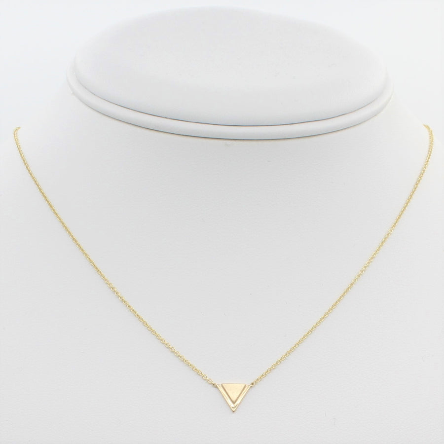 14k Yellow Gold Petite Double Triangle Single Station Pendant, front view of necklace displayed on a mannequin neckline.