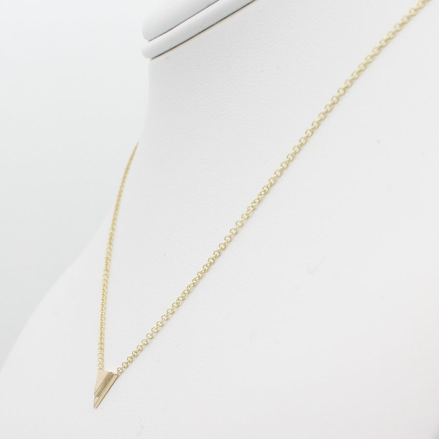 14k Yellow Gold Petite Double Triangle Single Station Pendant, right angle view of necklace displayed on a mannequin neckline.