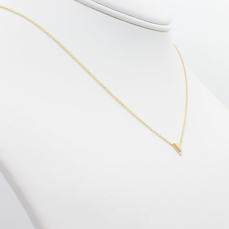 14k Yellow Gold Petite Double Triangle Single Station Pendant, left angle view of necklace displayed on a mannequin neckline.