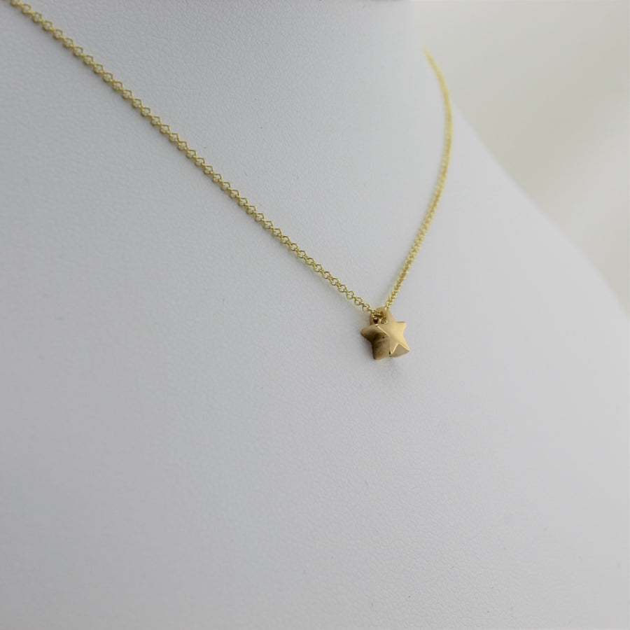 14k Yellow Gold Shining Star Pendant, left angle view.