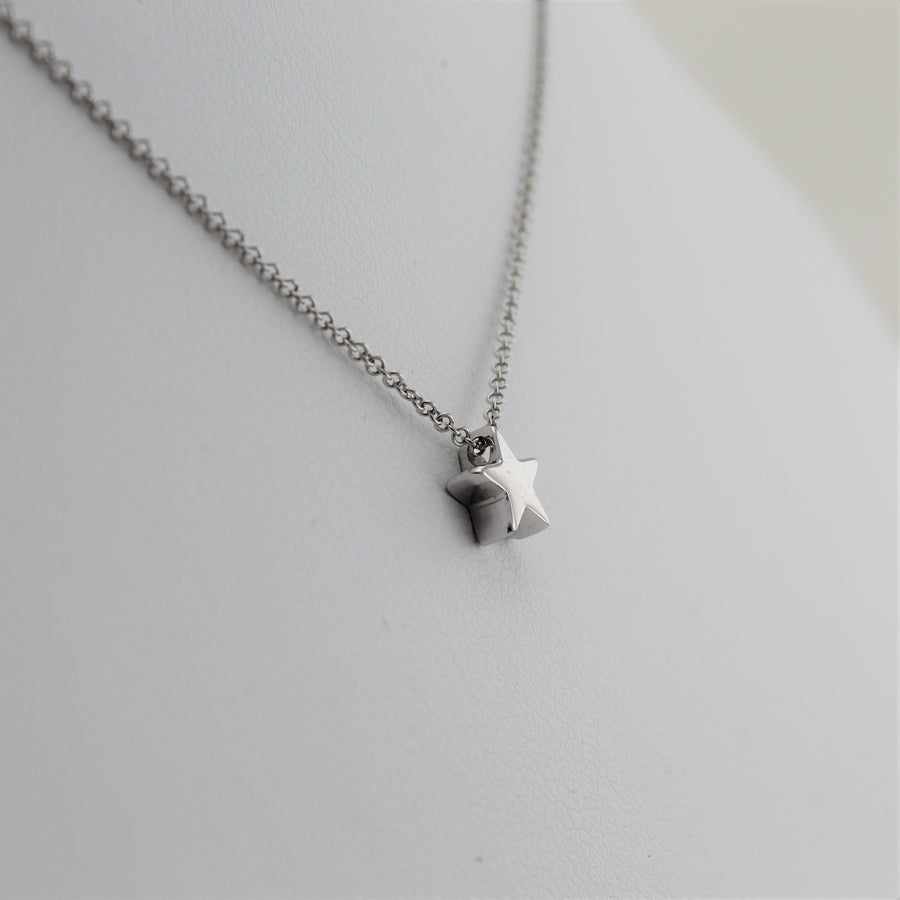 14k White Gold Shining Star Pendant, close-up left angle view of necklace highlighting the dainty star pendant.