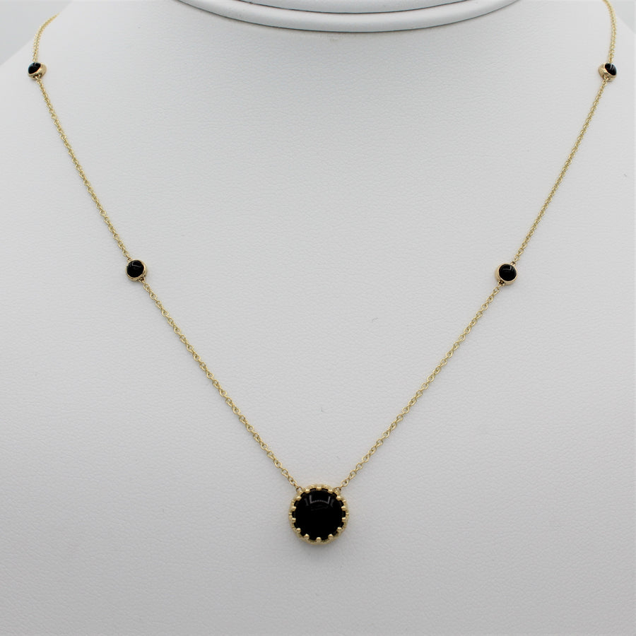 14k Yellow Gold Bewitched Black Onyx Station Necklace, front view of necklace displayed on a mannequin.