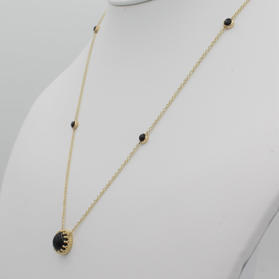 14k Yellow Gold Bewitched Black Onyx Station Necklace, right angle view of necklace displayed on a mannequin.