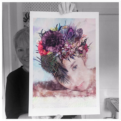 Jayne, co-founder & artist at Claude & Leighton, holding a print of Lady with the Mauve Carnation