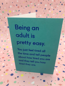 A blue typography card about how being an adult is tiring