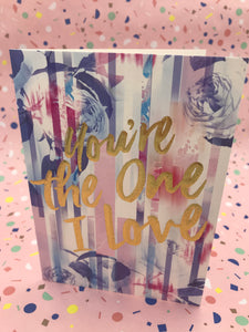A bright floral card with the words you're the one I love