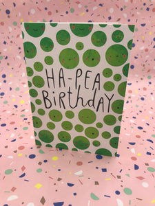 Greetings card with green peas on with the words ha pea birthday