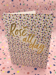A floral card with the words rose all day