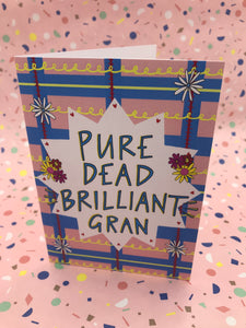 A brightly coloured card with flowers and illustrated tartan