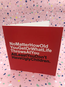 A red card with white and black text about not having ugly children