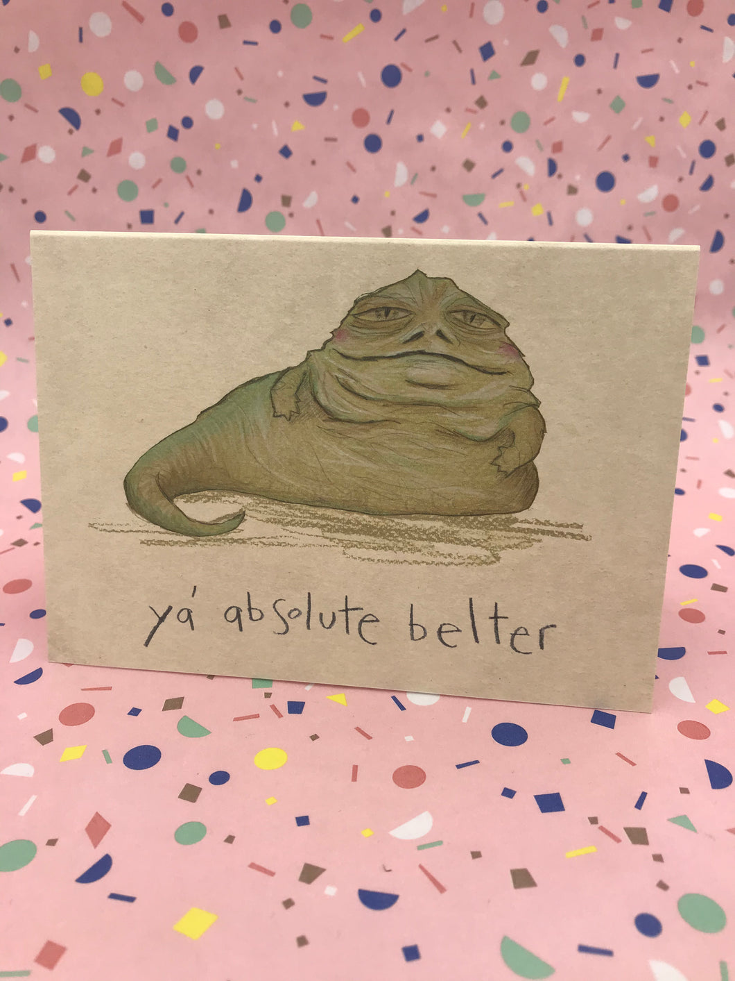 Illustrated drawing of Jabba the Hutt and the caption Ya Absolute Belter