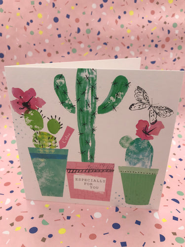 A card with pretty floral cactuses and black and white butterflies